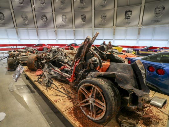 Corvettes damaged in a sinkhole collapse are displayed in the National Corvette Museum in Bowling Green, Ky.