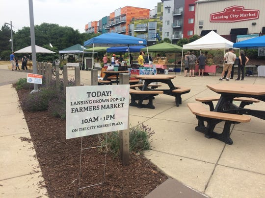 Lansing Grown produce is sold at a July 14, 2018 pop-up market in Lansing. A second pop-up will be held 10 a.m. to 1 p.m. Saturday on the river side of the Lansing City Market.