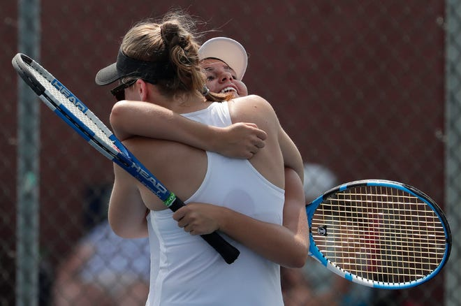 Xavier's Lilly Anne Van Ye hugs Camille Bonneville after they won their first match against Catholic Memorial in a tiebreaker during the 2018 Zephyr Invite on Wednesday at St. Mary Catholic in Fox Crossing.