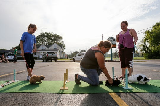 4-H club kids take their rabbits out for a final practice before the rabbit hopping competition at the Manitowoc County fair Tuesday, August 14, 2018, in Whitelaw, Wis. Josh Clark/USA TODAY NETWORK-Wisconsin