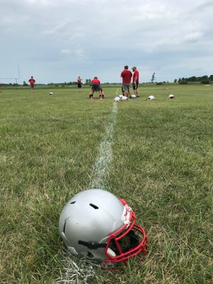 The Elgin football team works out during the first day of preseason practice on July 30. The Comets are hopeful they can compete for a Northwest Central Conference championship in their second year in the league and earn a playoff spot for the first time since 2005.