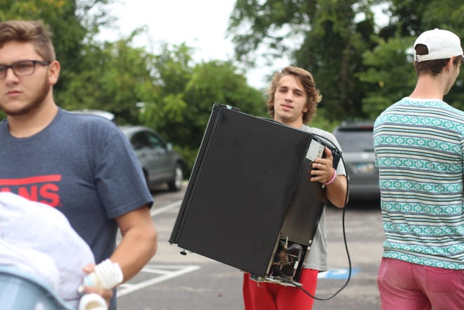 Christian Ison, of Powell, moves into his apartment at The Annex on move-in day for The Ohio State University at Marion.