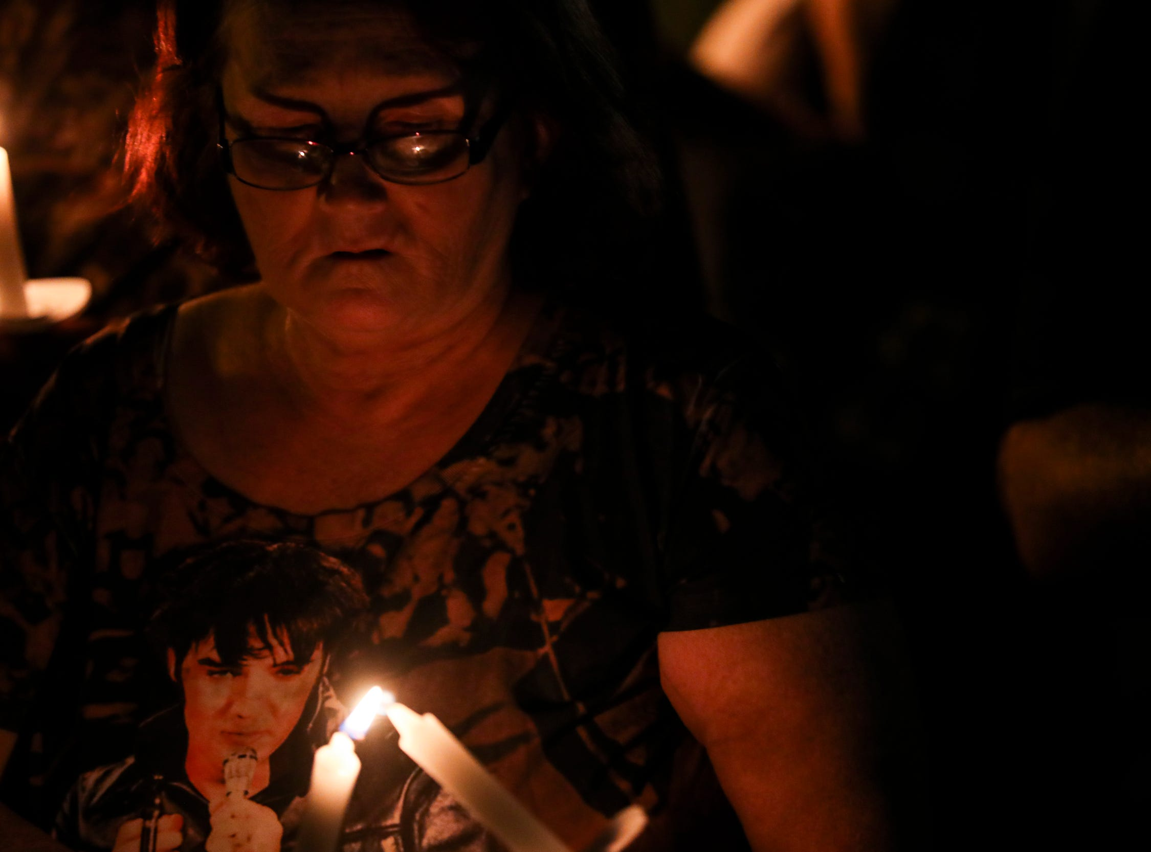 """August 14, 2018 - Elvis Presley light their candles at the start of a candlelight vigil during """"Elvis Week"""" that marks the 41st anniversary of Presley's Aug. 16 death."""