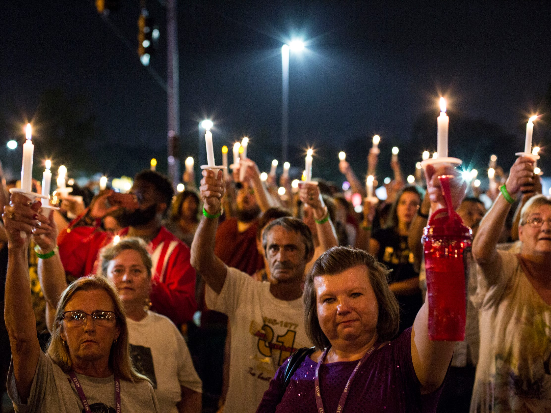 """August 14, 2018 - Elvis Presley raise their candles during a candlelight vigil during """"Elvis Week"""" that marks the 41st anniversary of Presley's Aug. 16 death."""