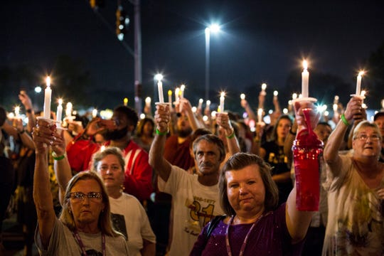 "Elvis Presley fans raise their candles during a candlelight vigil during ""Elvis Week"" in August 2018, which marked the 41st anniversary of Presley's Aug. 16 death. Music is the main draw for Memphis tourists worldwide, according to a report released by Memphis Tourism."