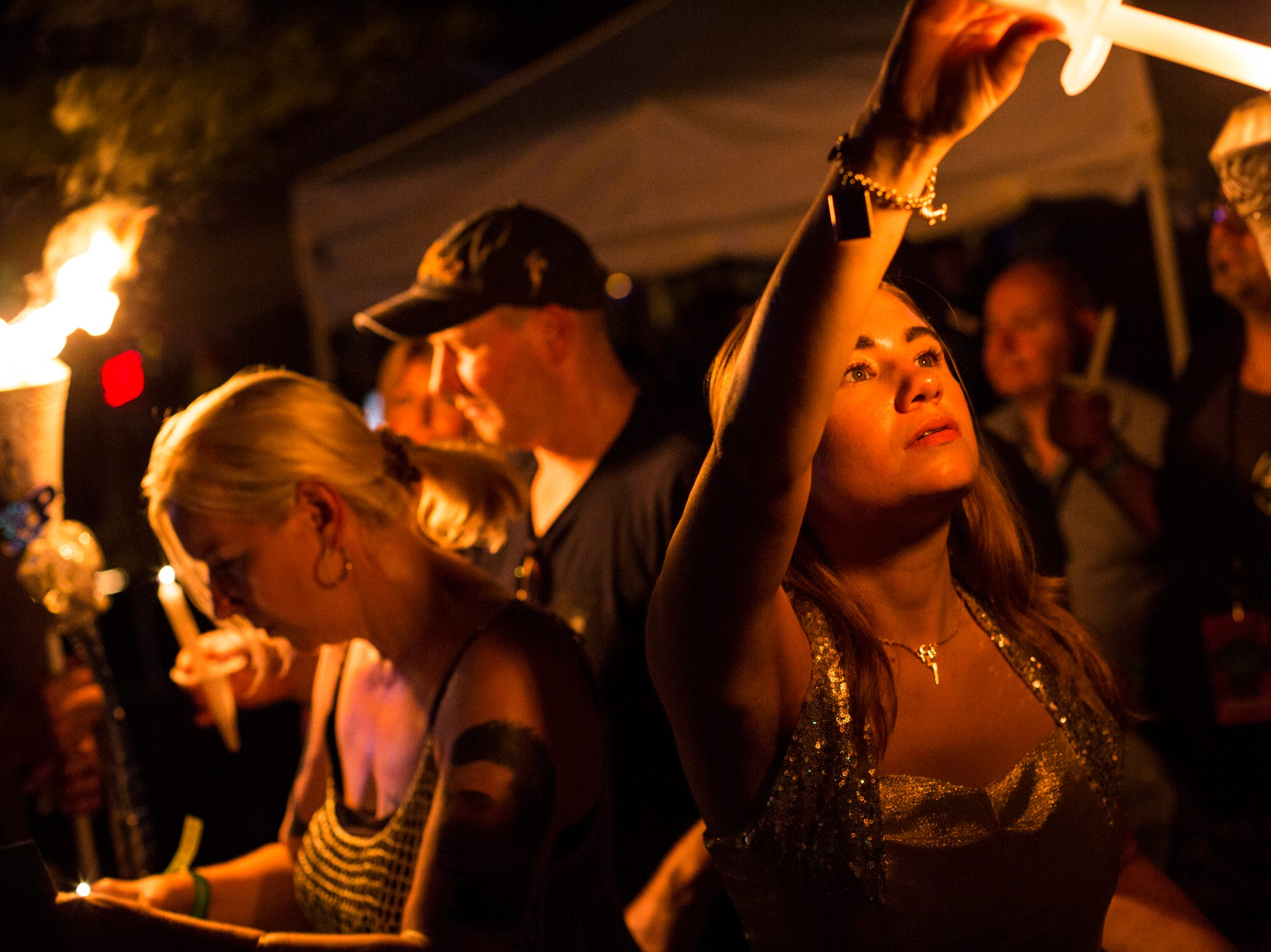 """August 14, 2018 - Elvis Presley fans light their candles before walking to PresleyÕs gravesite during the nighttime vigil. The event took place during """"Elvis Week"""" that marks the 41st anniversary of Presley's Aug. 16 death."""