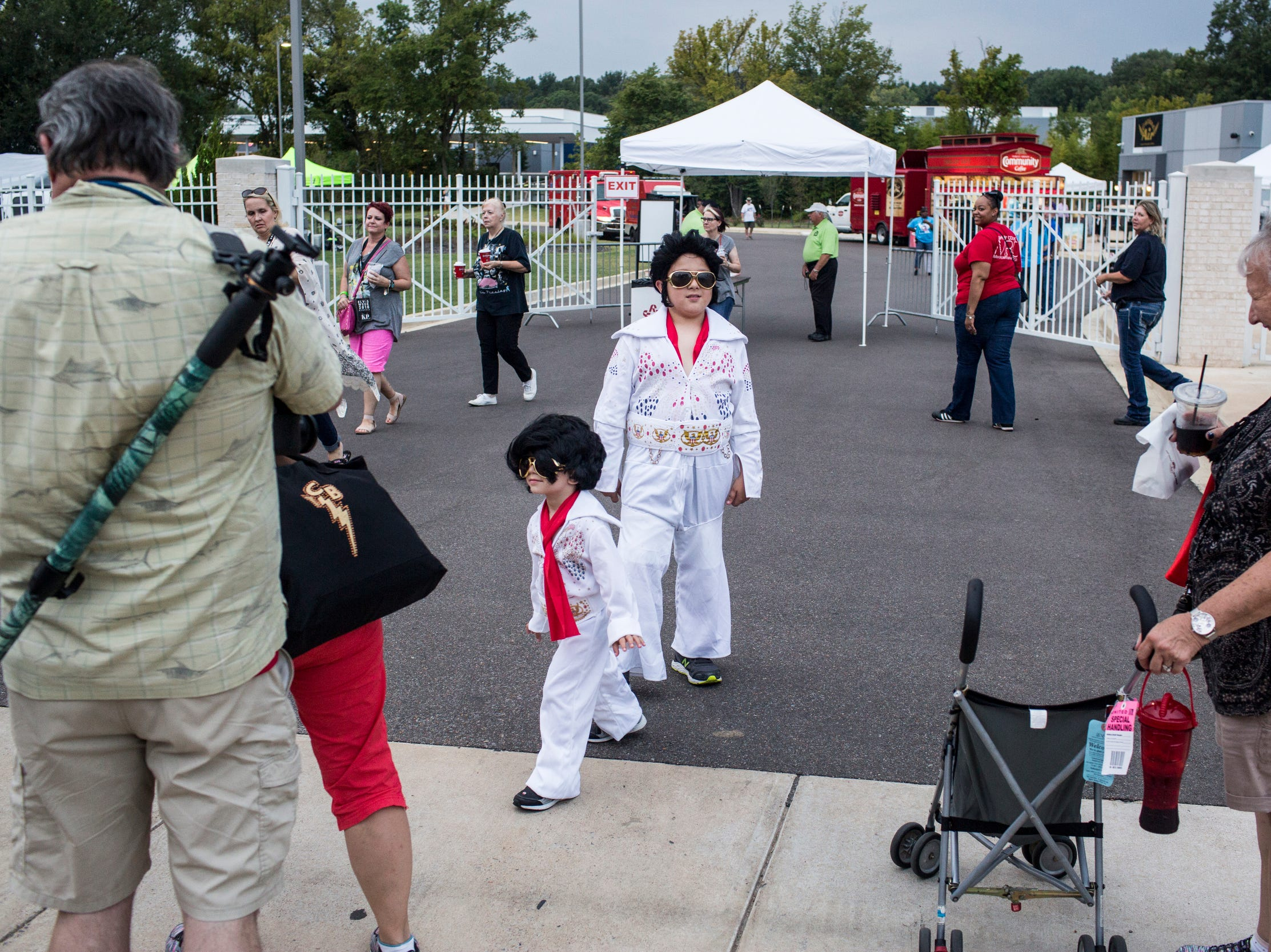 """August 14, 2018 - Reed Luterek, 4, and Preston Luterek, 9, arrive for the candlelight vigil during """"Elvis Week"""" that marks the 41st anniversary of Presley's Aug. 16 death."""