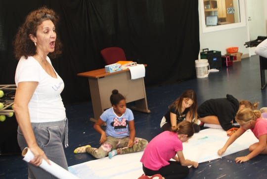 Gina Sisbarro puts her directorial foot down during a pre-performance practice at the Y.