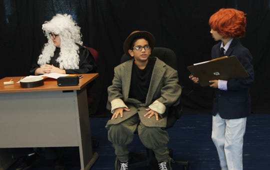 Ryan Sullivan as the judge, Carlos Seva as the Papa Bear, and prosecutor Sloan Wheeler take care of business during the TV courtroom drama spoof.