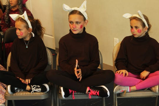 """The three little pigs, or """"Bacon Brothers"""" in the play, are Josephine Dorris, Chloe Doxsee and Ayla Vatansever."""