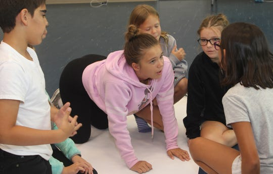 Young actors have a brainstorming session not related to the play, but intended to get their creative juices flowing, according to the director.