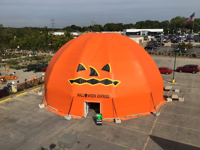 The Halloween Express tent store in Greenfield collapsed last October after a rainstorm. Now, the retailer's insurer is suing the tent's manufacturer and distributor, alleging the structure was flawed.