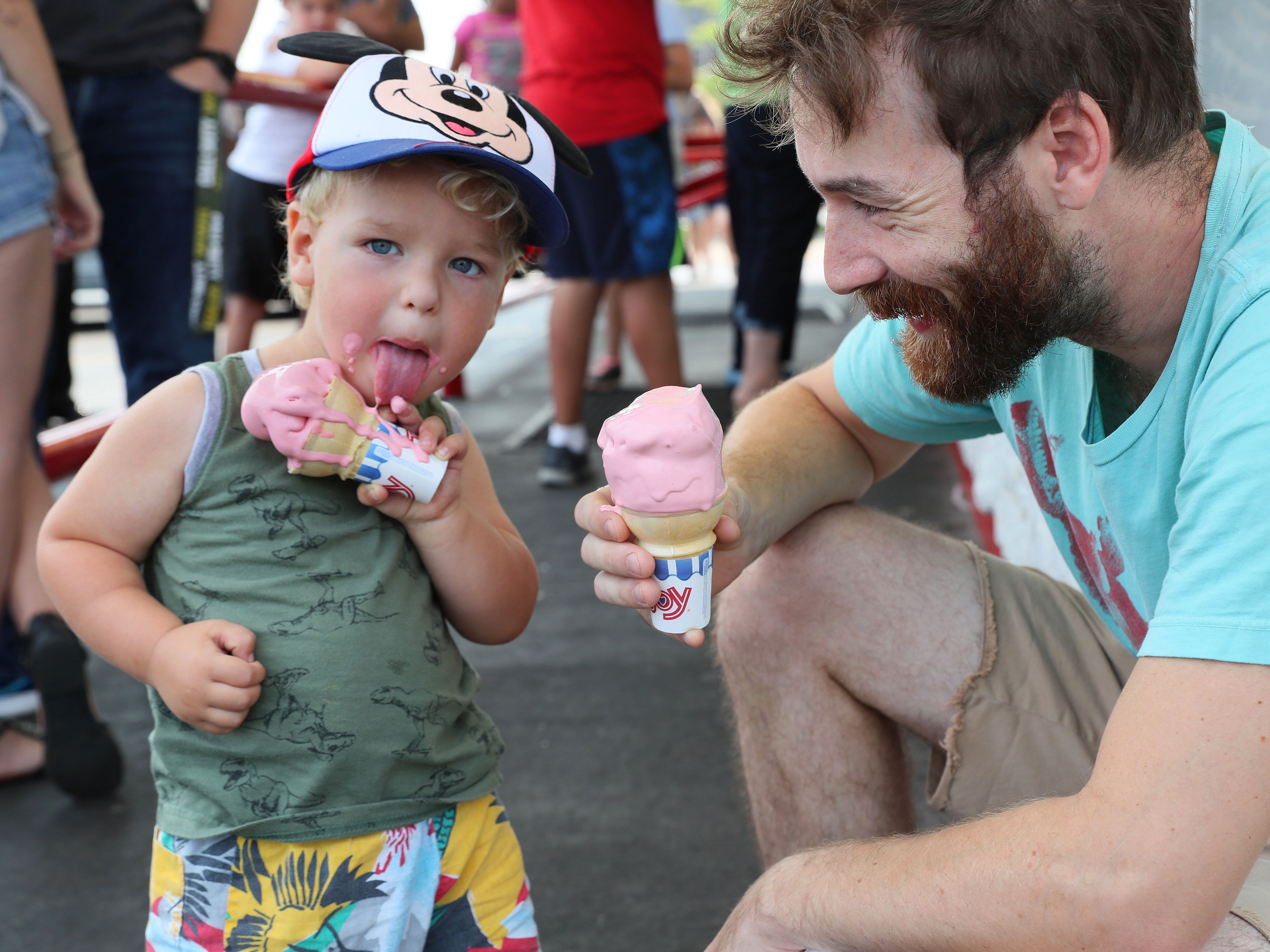 At Leon's Frozen Custard, Fin McGonegle,  2, and his father, Owen McGonegle of Milwaukee, enjoy their frozen custard on a hot summer afternoon.
