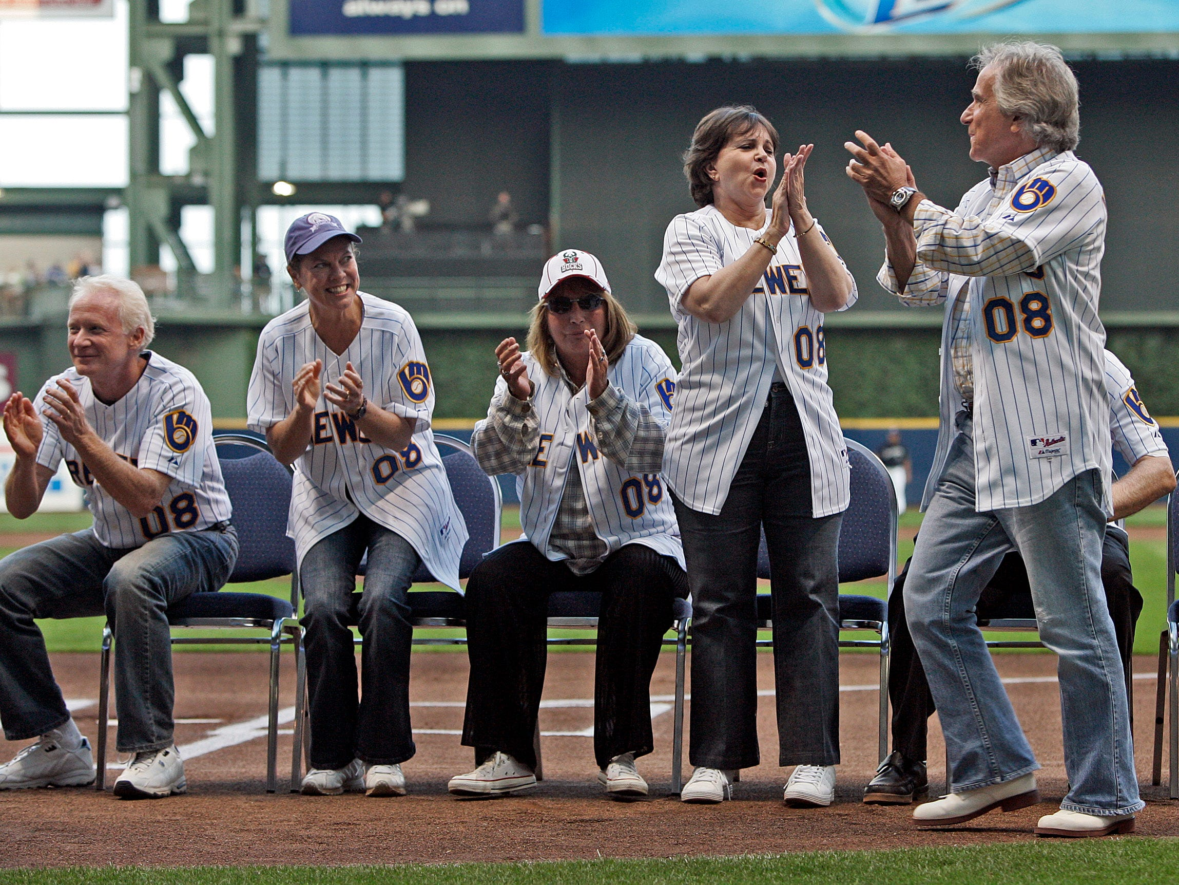 Don Most (from left), Erin Moran, Penny Marshall, Cindy Williams and Henry Winkler attend a pregame ceremony before the Milwaukee Brewers play the  Houston Astros at Miller Park on Aug. 19, 2008.