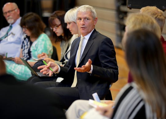 """Marquette University President Mike Lovell leads a subcommittee meeting to explore the creation of a Mobile Healing Brigade – an RV with trauma-focused social workers that can be deployed in resource-scarce neighborhoods in Milwaukee. With his wife Amy, Lovell has created a new consortium meant to tackle Milwaukee's epidemic of neurological trauma. They call their group SWIM – """"Scaling Wellness in Milwaukee."""""""