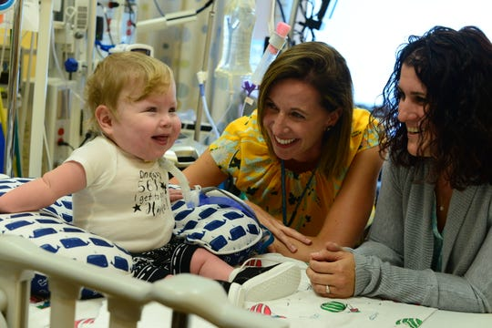 Two of Jax Schmalzriedt's doctors at Children's Hospital of Wisconsin, Tara Petersen (left) and Jennifer Henningfeld, enjoy the boy's company on the 561st and final day of his hospital stay from the day he was born three months prematurely.