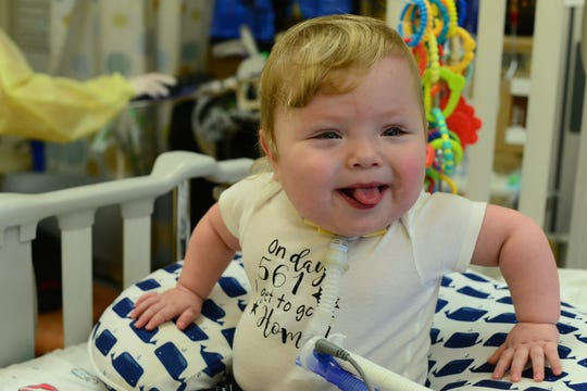 Jax Schmalzriedt has a cheerful disposition. He smiles easily.  He was hospitalized for 561 days after his birth.  Last month, the boy finally was able to go home to Wauwatosa with his parents, Kari and Gary.
