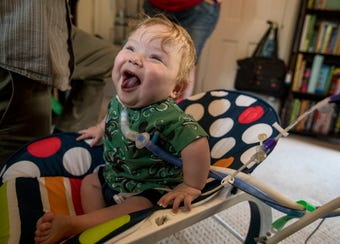 Jax Schmalzriedt, 19 months old, is finally home with his parents Kari and Gary Schmalzriedt after being hospitalized for 561 days.