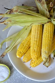 Grilled corn, ready to serve with butter and salt.