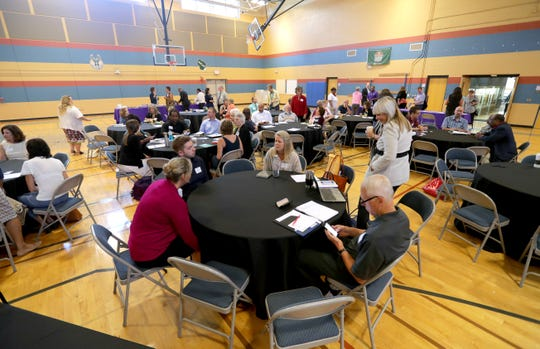 """SWIM """"Scaling Wellness in Milwaukee"""" strategy meeting attendees gather in a community center on Milwaukee's south side."""