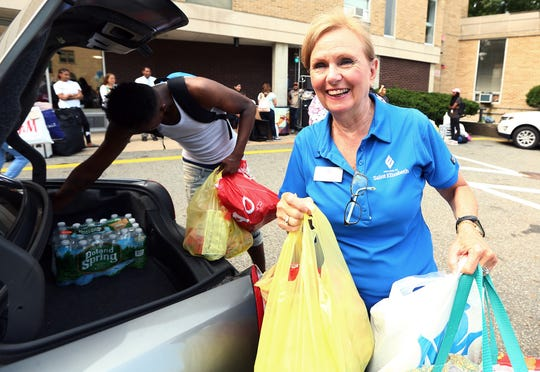 College of Saint Elizabeth President. Dr. Helen J. Streubert helping to move and welcome incoming freshmen, the class of 2022  to campus on move in day to Founders Hall.  August 16, 2017, Morris Township, NJ.