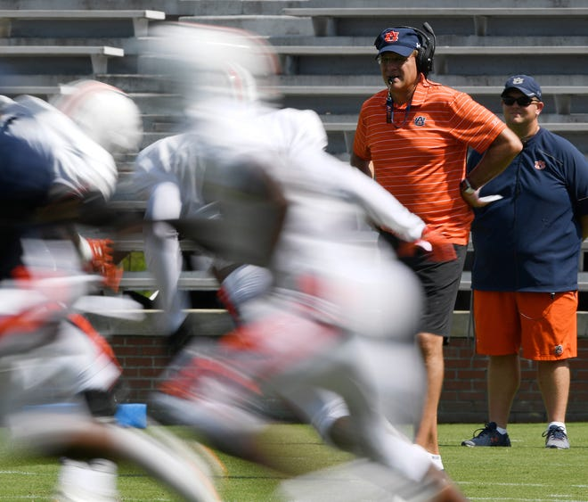 Auburn coach Gus Malzahn watches during a scrimmage during practice.