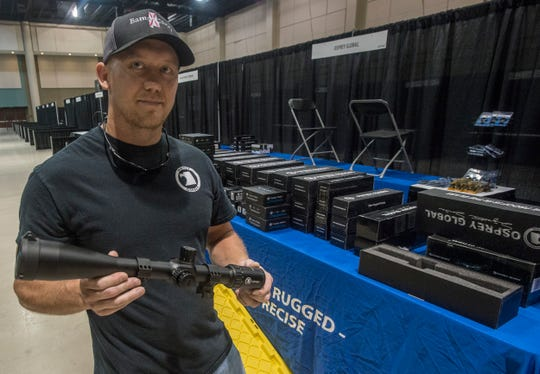 Adam Bruner, an authorized Osprey dealer, displays a long range Osprey scope. Vendor set up for Buckmasters Expo 2018 took place Thursday, Aug. 16, 2018. Buckmasters Expo will be held at the Convention Center in downtown Montgomery on Friday, Saturday and Sunday.