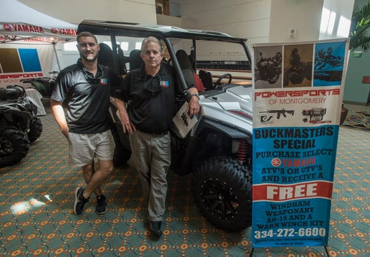 Josh Donnell, left, and David Huneycutt of Powersports of Montgomery are offering a deal - a free AR-15 rifle with the purchase of select ATV and side by side vehicles. Vendor set up for Buckmasters Expo 2018 took place Thursday, Aug. 16, 2018. Buckmasters Expo will be held at the Convention Center in downtown Montgomery on Friday, Saturday and Sunday.