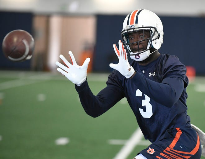 Auburn wide receiver Nate Craig-Myers makes a catch during practice on Thursday, April 5, 2018 in Auburn, Ala.