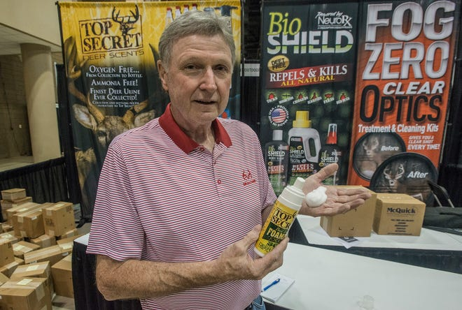 """Eddie Salter from Evergreen, a world champion turkey caller with his own TV show """"Turkey Man"""" on the Sportsman Channel, show off the Top Secret Deer Scent foam. Vendor set up for Buckmasters Expo 2018 took place Thursday, Aug. 16, 2018. Buckmasters Expo will be held at the Convention Center in downtown Montgomery on Friday, Saturday and Sunday."""