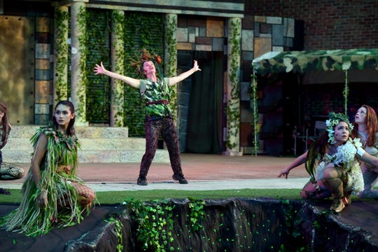 """Denice Hicks performs as Puck in a production of """"A Midsummer Night's Dream."""""""