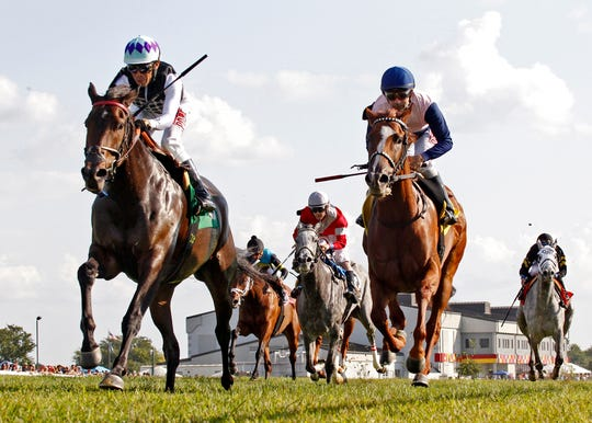 The race track at Kentucky Downs is America's only European-style turf course.
