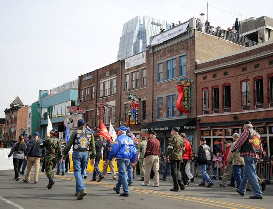 Military veterans participate in the Veterans Day parade on Broadway on Nov. 11, 2017.