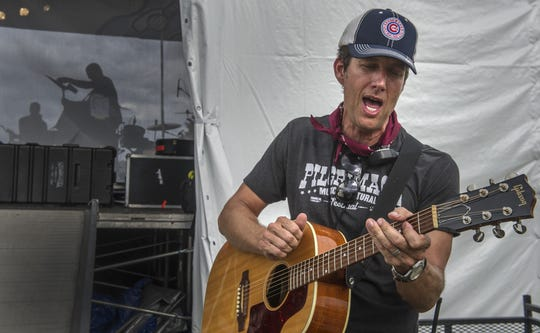 Festival founder and Franklin resident Kevin Griffin practices a song backstage Sept. 26, 2015, at the Pilgrimage Music & Cultural Festival at the Park at Harlinsdale on in Franklin.