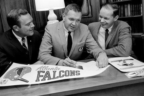 Bud Erickson, center, assistant to the president of the Atlanta Falcons, is flanked by Nashville Exchange Club's Homer Gibbs Jr., left, and John Barton during signing of a contract Feb. 29, 1968, for an exhibition game Aug. 17 between the Falcons and the New York Giants at Dudley Field.