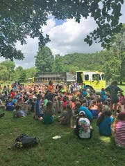Children at Camp Whippoorwill get a visit from the Williamson County Rescue Squad.