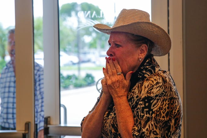 Mary Warder reacts to children lined up with her surprise gift Tuesday, Aug. 14, 2018. Moms from the Naples Moms 2.0 Facebook group raised money to buy Warder a reliable car. Known as Miss Mary, she has worked at the Coastland Center mall carousel for many years. She maintains her joy while working three jobs, and her car broke down recently — the moms wanted to give back to the women who has given so much to their children.