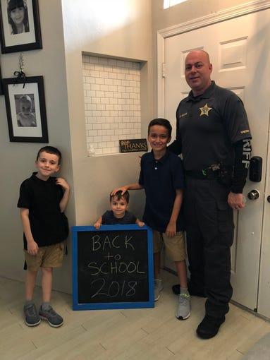 Sgt. DeMange, John, Anthony and little Jacob.