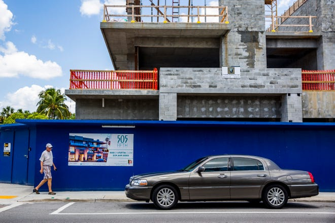 Construction along Fifth Avenue South in downtown Naples on Thursday, Aug. 16, 2018. Despite overall job losses, Collier Countycontinues to add jobs in some sectors, namely construction, with1,200 jobs created in thatindustry alone over theyear.