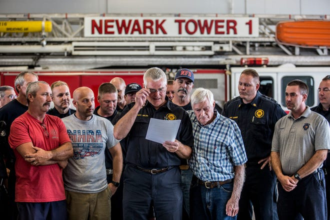 Newark Fire Captain Ron Walsh is embraced by his uncle, Carl Miller, and surrounded by fellow firefighters as he gives an emotional farewell to the Newark Fire Department. Walsh is retiring after 41 years.