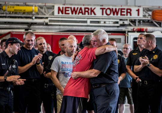 Newark Fire Captain Ron Walsh is embraced by fellow firefighter, Brian Jaccaud after giving an emotional farewell to the Newark Fire Department. Walsh is retiring after 41 years.