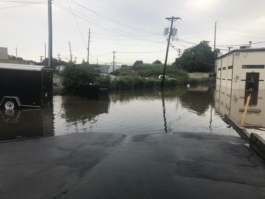 Flood water rising last Saturday in Woodland Park following a heavy rainstorm.