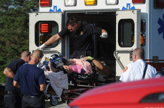 A man is transferred from a Truro ambulance to a MedFlight helicopter after being attacked by a shark, Wednesday, Aug. 15, 2018 in South Wellfleet, Mass. A man swimming off Cape Cod was attacked by a shark on Wednesday and was airlifted to a hospital. It was the first shark attack on a human on the popular summer tourist destination since 2012.