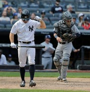 New York Yankees' Brett Gardner reacts after striking out with the bases loaded during the ninth inning of a baseball game against the Tampa Bay Rays at Yankee Stadium Thursday, Aug. 16, 2018, in New York. The Rays defeated the Yankees 3-1.