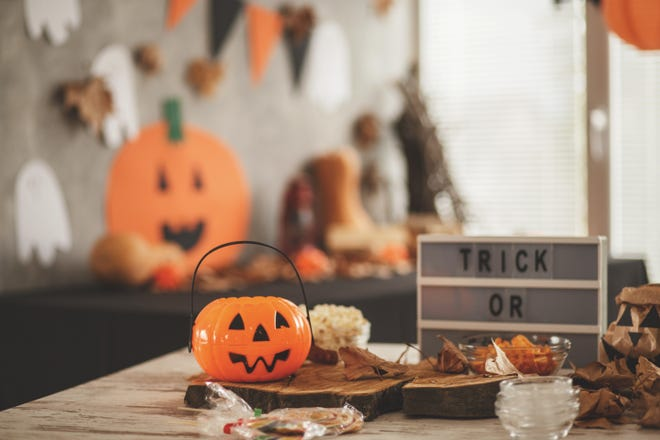A table decorated for a Halloween party.