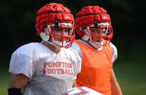 Photo of Running Back/LB in senior Frankie Negrini (L) of Pompton Lakes practices with his teammates at Herschfield Park in Pompton Lakes on 08/16/18.