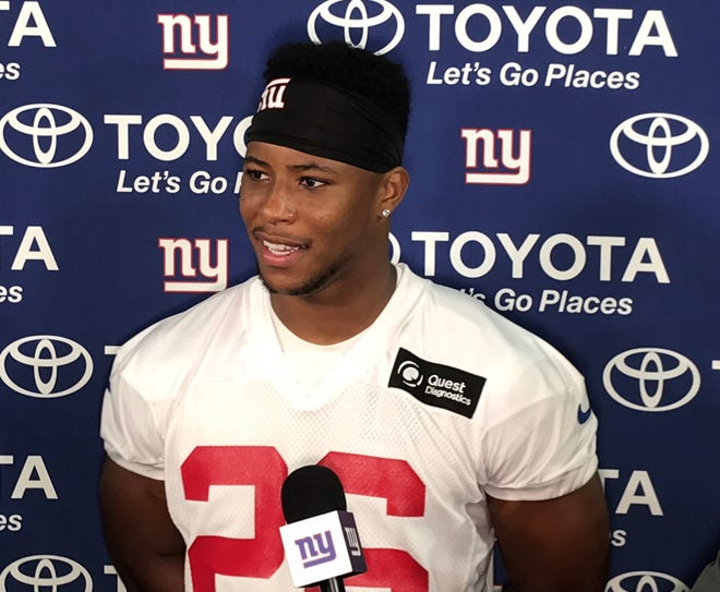 NY Giants rookie running back Saquon Barkley talks to the media after Thursday's final joint practice against the Detroit Lions in Allen Park, Mich.