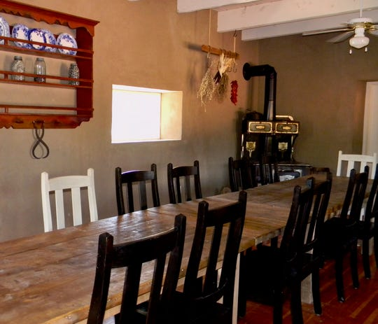 Among the displays inside the Gutiérrez-Hubble Home is this long dining table needed to seat the large family.