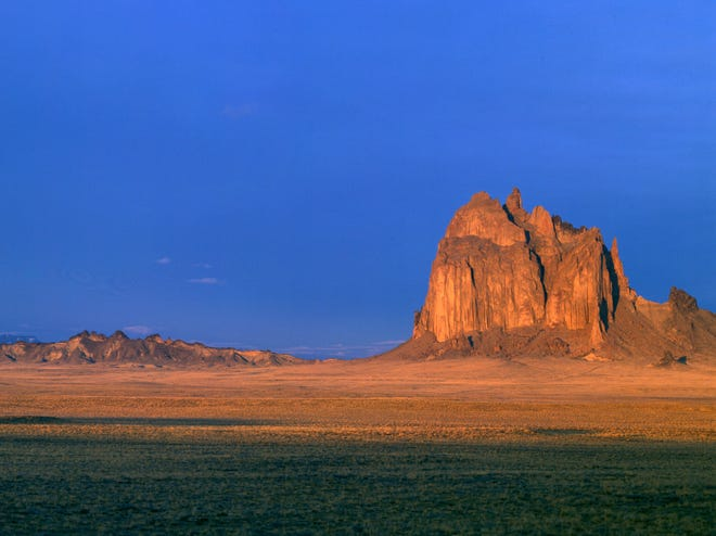 Shiprock is a massive volcanic rock formation in the northwest region of New Mexico, near Four Corners, on land governed by the Navajo Nation.