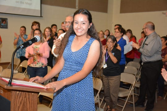 Maria del Sol Nunez Pena receives a standing ovation at the Gadsden Independent School District board meeting after an introduction as the National Spanish Spelling Bee champion.